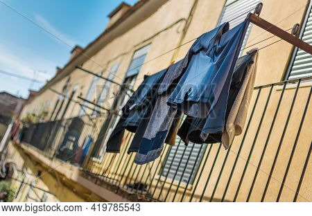 Laundry On Clothes Line Rope Under The Old Window With Shutters, Mediterranean Old Town, Symbolic Ph