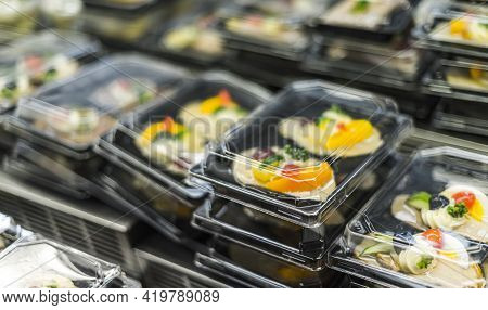 Delicatessen Products Put Up For Sale In A Supermarket Fridge