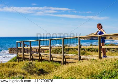 Tourist Woman Walking Relaxing On Beach Seashore, Enjoying Sunlight. Cala Magre In Calblanque Region