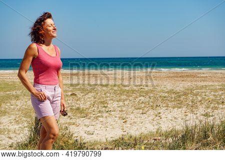 Mature Woman Walking On Beach, Relaxing At San Pedro Del Pinatar Park, Murcia Spain. Summer Holidays