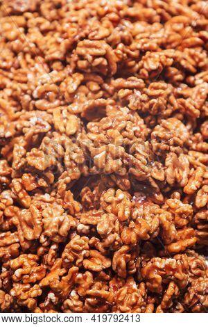 Heap Of Walnuts In Sugar Glaze. Sweet Walnut Dessert (selective Focus)