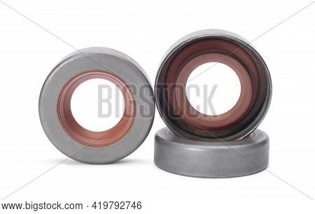 Three Rubber Reinforced Oil Seals For Shafts And For Car Motor Engines, Isolated On White Background