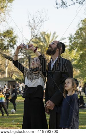 Tel Aviv, Israel - March 31st, 2021: A Father And His Children Looking At Visitors In A Rope Adventu