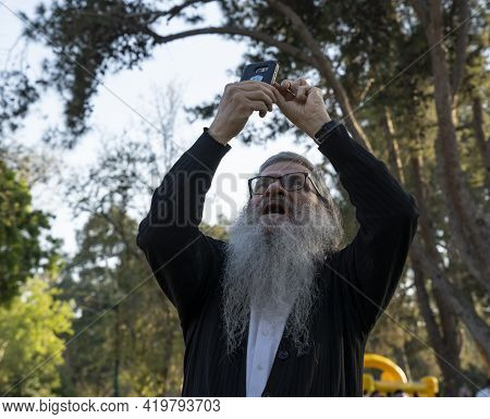 Tel Aviv, Israel - March 31st, 2021: A Man Using His Mobile Phone To Take Pictures In A Tel Aviv, Is