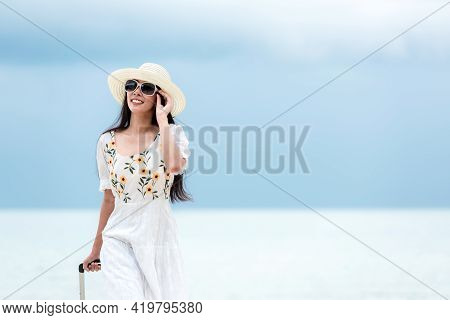 Summer Vacations. Lifestyle Woman Relax And Chill On Beach.  Asian Happy Young People Wearing White