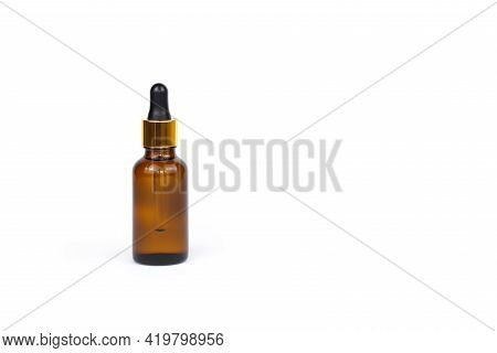 Dropping Essential Oil Into Glass Bottle, Bottle Of Hyaluronic Acid With Pipette Isolated On White B