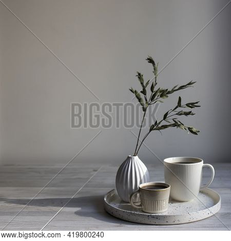 Minimalistic Scandinavian Style. Two Cups Of Coffee Of Different Sizes For Two On A Tray On The Tabl