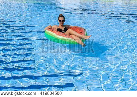 Summer Fun. Happy Young Sexy Girl In Bikini Swimsuit, Sunglasses With Inflatable Rubber Ring Floatin