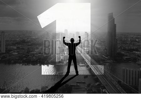 Double Exposure Silhouette Of Man Standing Inside Number One With Fists Raising Up Over The City Bac
