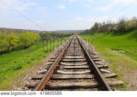Railway On The Green Meadow. Rails And Sleepers. Railway Tracks In Rural Areas. Green Meadows And Yo
