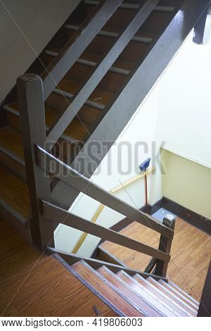 Downward View Of Staircase In Old Worn Office Building