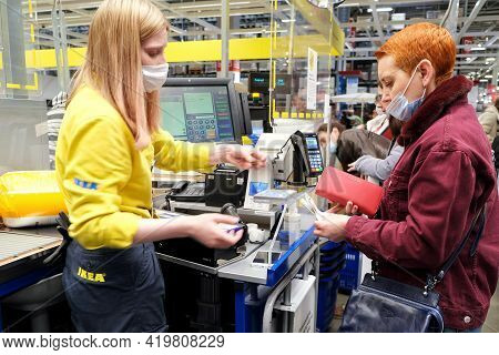 A Young Woman Pays For Purchases At The Checkout Of An Ikea Hypermarket. Saint-petersburg. Russia. M