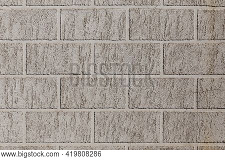Artificial Brick-like Pattern Embossed In Flat Plaster Surface
