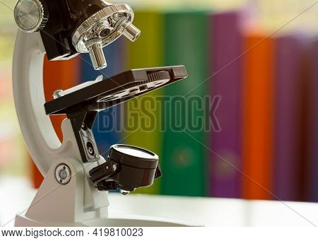 Close Up Microscope On Table With Laboratory Equipment In Chemical Lab; Science Laboratory Research