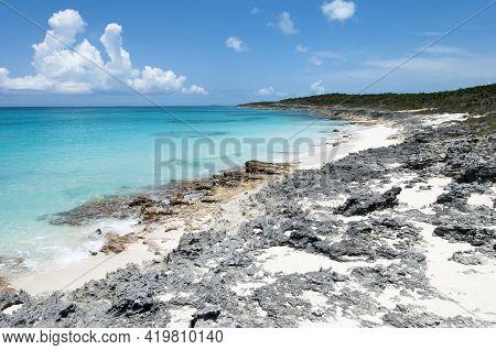 The Scenic View Of Rocky Wild Beach On Half Moon Cay Island (bahamas).