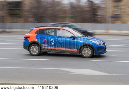 Moscow Carsharing Belka Car. Kia Rio Hatchback Rushes Along The Street On High Speed. Moscow, Russia