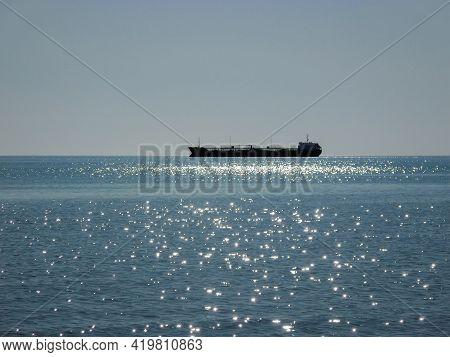 Silhouette Of A Ship At Sea. Oil Tanker In The Caspian Sea. Kazakhstan. Mangistau Region. 22 October