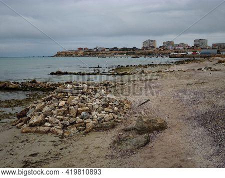 A Pile Of Stones On The Shore Of The Caspian Sea. Aktau City. Kazakhstan. Mangistau Region. 12 Octob