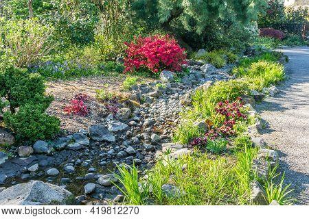 A Landscape Shot Of A Dry Creek Bed In Seatac, Washington.