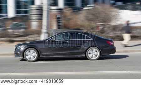 Mercedes-benz Cls-class C218 At The City Road In Motion. Black Car Driving Along The Presnenskaya Na