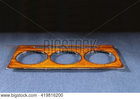 Veneering Of Parts With Veneer For The Car Interior. Decorative Details On A Black Background