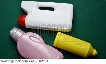 White, Pink And Yellow Plastic Bottles From Recyclable Type Of Polymer. Used Plastic Cans With Remov