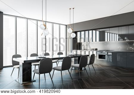 Interior Of Modern Kitchen With Wooden Floor, Furniture, Table And Chairs, Panoramic Window. Dining