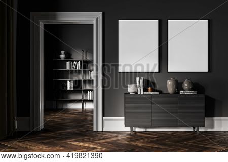 Dark Living Room With Grey Wooden Commode, Bookshelf On Background, Minimalist Decoration With Parqu