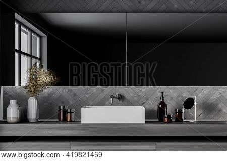Grey Bathroom Interior With One Sink And Long Mirror With Reflection On Windows, Drawer With Bathing