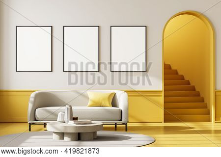 Apartment Interior With White Couch And Coffee Table On Carpet With Yellow Floor. Mockup Blank Wall