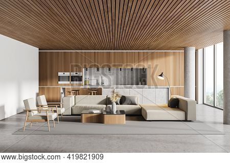 Interior Of Modern Kitchen With Wooden Ceiling, Furniture, Table And Chairs, Big Couch In The Middle