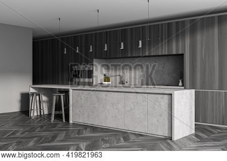 Interior Of Modern Kitchen With Wooden Floor, Furniture, Table And Chairs. Dining And Cooking Area.