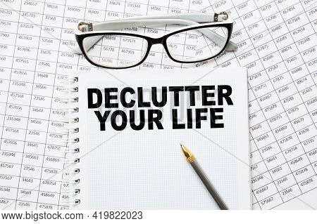Notepad With Text Declutter Your Life On The Office Desk With Stationery. A Blank Notepad For Enteri