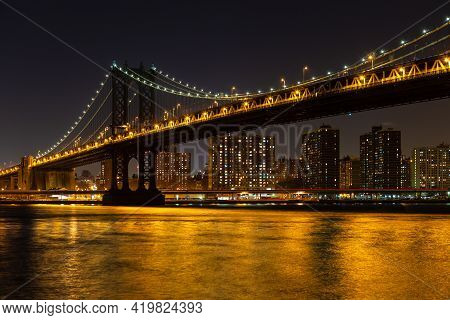 Manhattan Bridge From Brooklyn To Manhattan At Night, Before Lower East Side Waterfront, New York, U