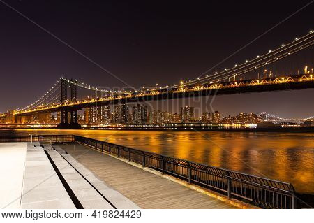 Manhattan Bridge From Brooklyn To Manhattan At Night, With A Viewing Platform On Brooklyn Side.