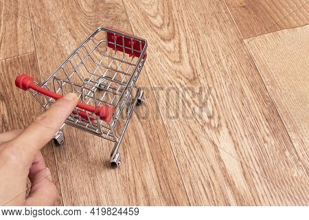 Small Decorative Cart On A Wooden Background, Copy Space