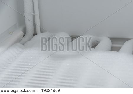 Household Appliance Freezer As A Power Hog When Defrosting - Close-up