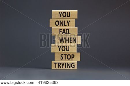 Concept Of Building Success Foundation. Businessman Hand. Wooden Blocks With Words 'you Only Fail Wh