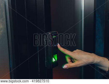 Closeup Of A Womans Finger Entering Password Code On The Smart Digital Touch Screen Keypad Entry Doo