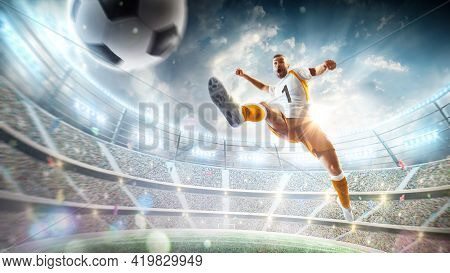 Soccer Kick. A Soccer Player Kicks The Ball In Air Fashion. Professional Soccer Player In Action. St