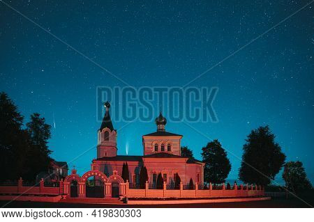 Korma Village, Dobrush District, Belarus. Comet Neowise C2020f3 And Meteor In Night Starry Sky Above