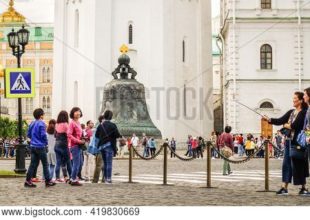 Moscow, Russia - 06 14 2016: Tourists In Moscow Kremlin Crossing The Road Towards The Tsar Bell, A M
