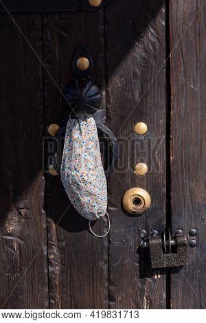 Vintage Wooden Door. Door Vintage House Lock. Protective Mask Against Bacteria And Viruses On Door