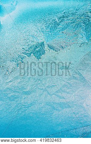 Blue Frosty Glass Ice Background, Natural Beautiful Frost Ice Pattern In Sunset Light. Winter Abstra