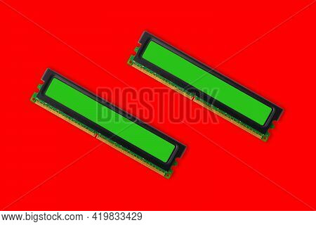 Modules Of Computer Ram Random Access Memory On A Red Background.