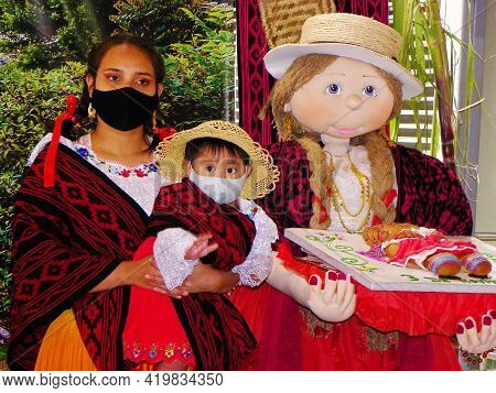 Cuenca, Ecuador - November 2, 2020: Young Woman With Little Daughter In Protective Masks And Big Man