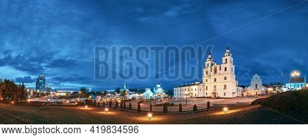 Minsk, Belarus. Illuminated Cathedral Of Holy Spirit In Minsk At Evening Or Night Street Lights . Fa