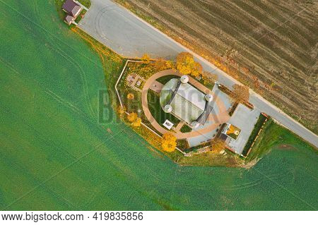 Synkavichy, Zelva District, Hrodna Province, Belarus. Aerial Birds-eye View Church Of St. Michael Ar