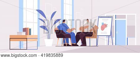 Doctor Cardiologist In Uniform Examining Male Patient Medical Consultation Cardiology Healthcare Con