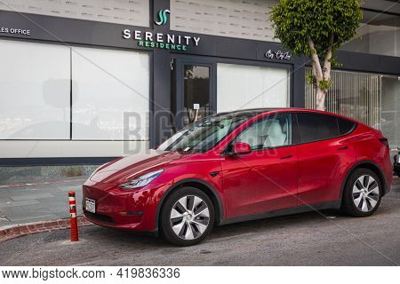 Alanya, Turkey - April 17 2021: Red Tesla Model X  Is Parked  On The Street On A Warm Summer Day Aga